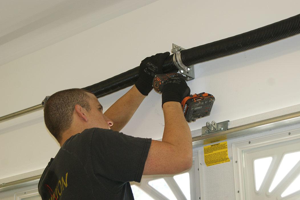 fixing garage doorGarage door broken spring repair  torsion spring repair